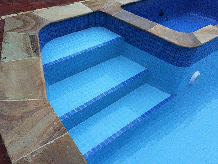 Tiled swimming pool steps after renovation photo