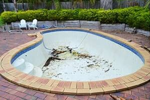 Marblesheen-waterline-tiles-swimming-pool-before Pool Renovations Melbourne - Swimming Pool Experts